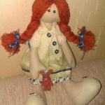 Кукла с рыжими косичками